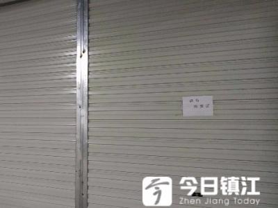 朱方大厦车位紧张却成仓库 商户很苦恼 律师:不能改变停车功能