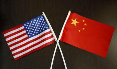 人民日报钟声:美国制裁中国军方意欲何为