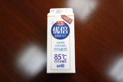 """牛奶盒上标识""""85℃"""",光明被85度C告了,法院这样判"""