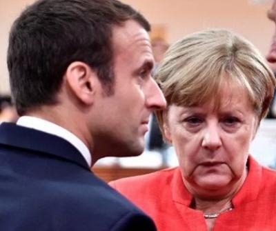 """马克龙、默克尔:若英国决定推迟""""脱欧"""" 法德会予以考虑"""