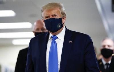 特朗普自疫情暴发以来首次公开佩戴口罩