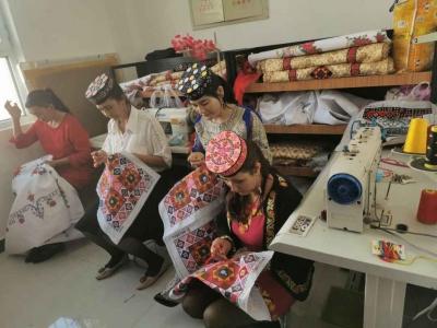 【走进未脱贫摘帽县】新疆阿克陶:搬进新家,家庭妇女当起了小老板